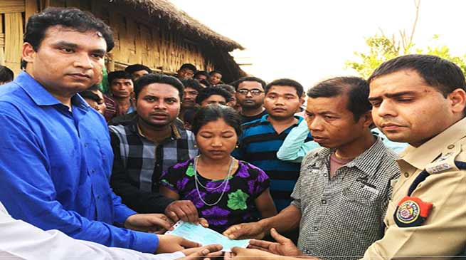 Assam: DC hands over cheque as ex-gratia to family members of raped and murdered victim