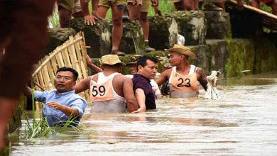 Photo of Manipur: IAS officer helping marooned people in waist-deep water