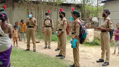 Photo of Assam: NCC Girls cadets educating villagers about AROGYA SETU
